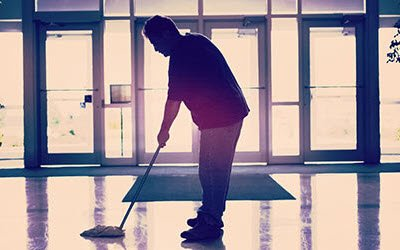 Man mopping floors in a big building