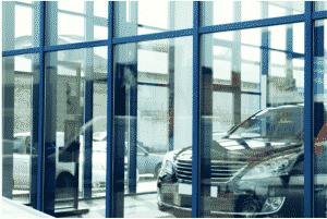 Looking in car dealership through spotless windows